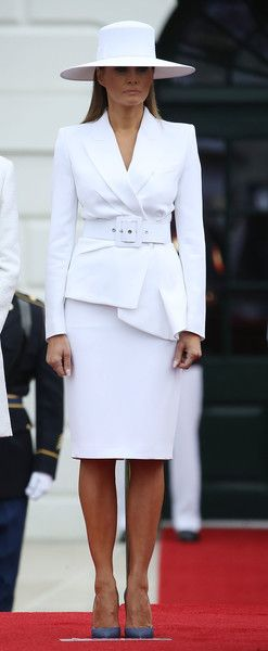 b046f12a107e Melania Trump Skirt Suit - Melania Trump looked sharp in a structured white  skirt suit by Michael Kors while welcoming the French President to the White  ...