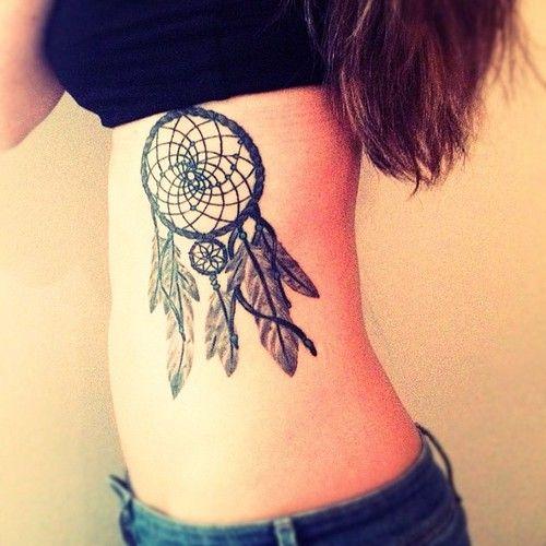 tattoos of dream catchers for girls   http://www.tattoobite.com/nice-dream-catcher-tattoo-on-ribs-for-girls/