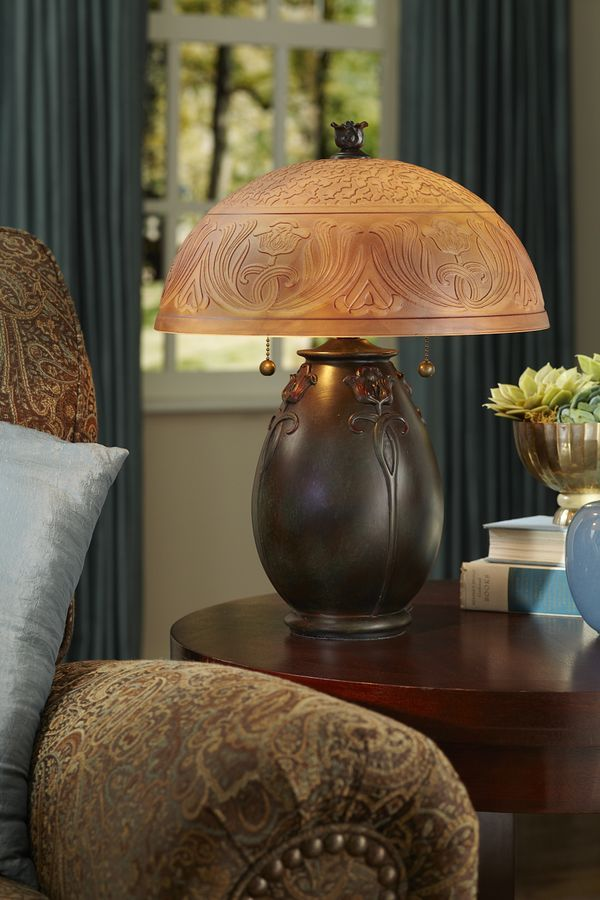 Del mar fans lighting see more the organic look of this quoizel table lamp features an etched glass shade in a classic