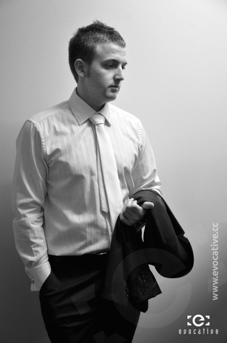 Black and white portrait of Ben the groom holding his suit jacket, while waiting for the groomsmen before leaving for the ceremony, at Woodlands of Marburg. #WeddingPhotography