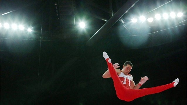 Kristian Thomas of Great Britain competes on the horizontal bar in the Artistic Gymnastics men's team final on Day 3 of the London 2012 Olympic Games at North Greenwich Arena.