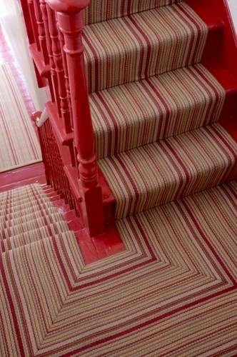Red bannister and stripy carpet