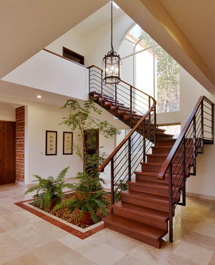 escalera: Pasillos y recibidores de estilo por Excelencia en Diseño
