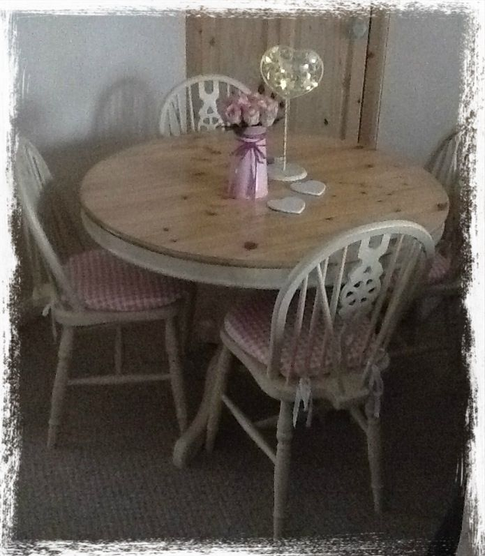 My up-cycled shabby chic table and chairs, found on the Internet separately and given a good sand down and new paint job :)