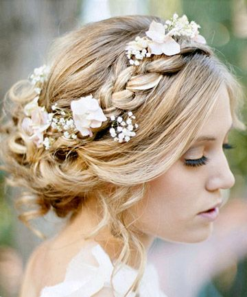 Love this wedding hair style with the pretty braid and flowers intertwined.  Trowbridge, Wiltshire.We stock a wonderful selection of designer wedding dresses and run a closed door policy to provide you with the ultimate shopping experience.Find your dream dress here with us. www.devlinbridalcouture.co.uk xx