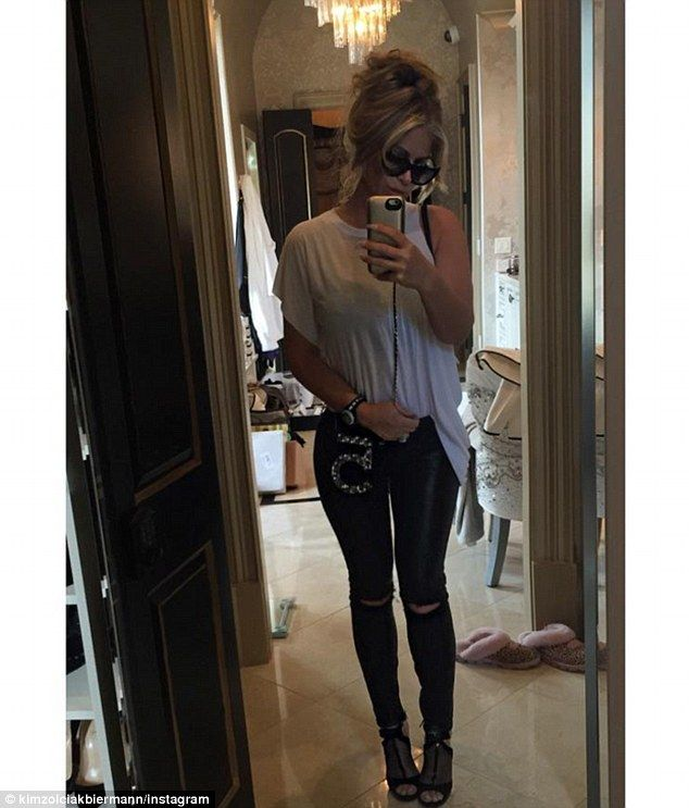 Showing off her Chanel: Kim Zolciak posted another flattering mirror selfie on Tuesday aft...