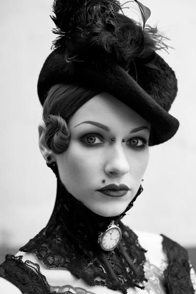 a perfect blend of looks.  esp. like the piercings and tiny sideburn-bun.  Which is what I shall name it.    steampunk, goth, alternative, victorian loveliness