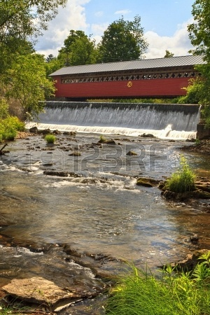 Waterfalls on the Walloomsac River below the historic Paper Mill Village Covered Bridge in Bennington, VT