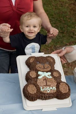 Teddy Bear Cake. Jordy could do a pink bow and write her name on it. I'd be willing to help. (Just a picture, no link for directions)