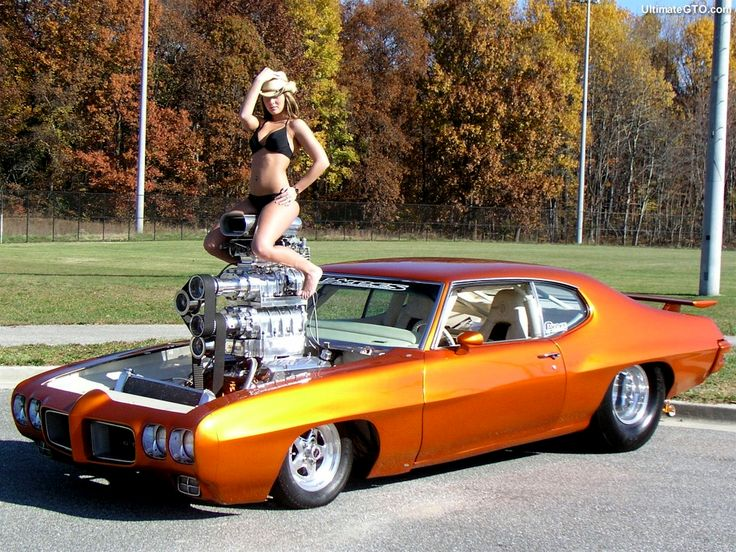 Girl sitting on a blower in a Pontiac GTO. | Pro-Touring ...