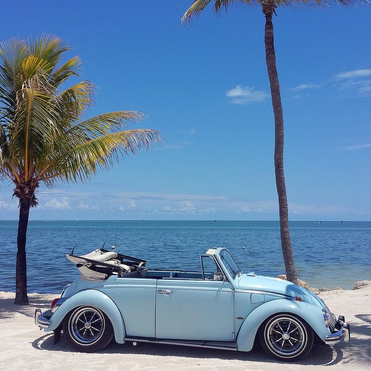 Gustavo Ramirez, from Miami, Florida. His 1969 L50B (48) Diamond Blue VW Convertible, 1500cc stock motor. He's had it since 1996. It's got a bunch of original Empy accessories