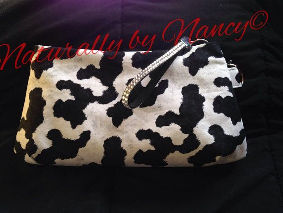 Cowhide print clutch with added bling for the wrist strap