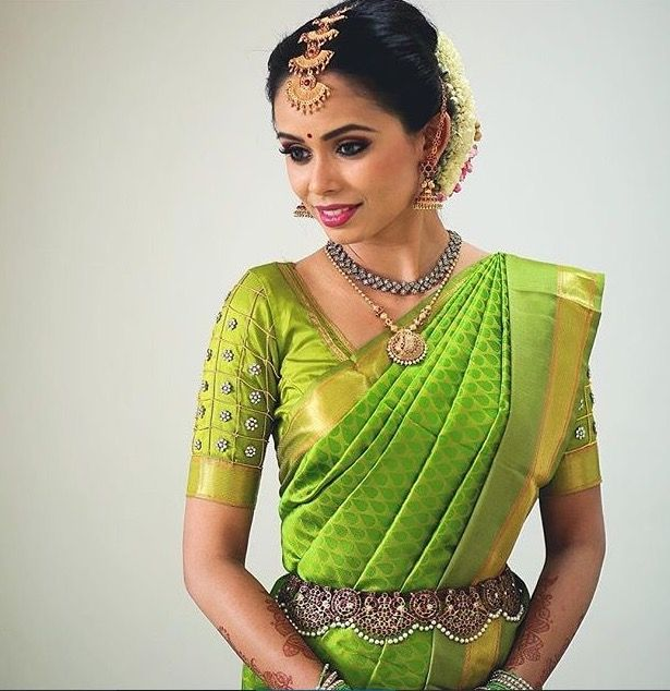 South Indian bride. Gold Indian bridal jewelry.Temple jewelry. Jhumkis.Greensilk kanchipuram sari.braid with fresh jasmine flowers. Tamil bride. Telugu bride. Kannada bride. Hindu bride. Malayalee bride.Kerala bride.South Indian wedding.