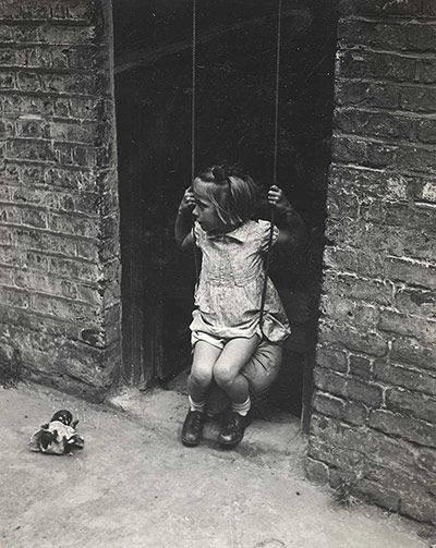 A young girl on a swing is captured in one of Bill Brandt's evocative images commissioned by the Bournville Village Trust and taken in Bournville, a suburb of Birmingham, between 1939 and 1943.