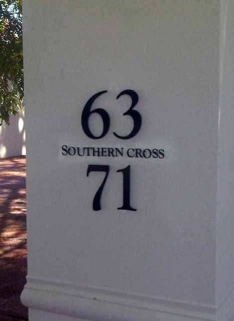 Stainless Steel Sign, Grade 3CR12 powder-coated black and mounted with Mounting Studs.