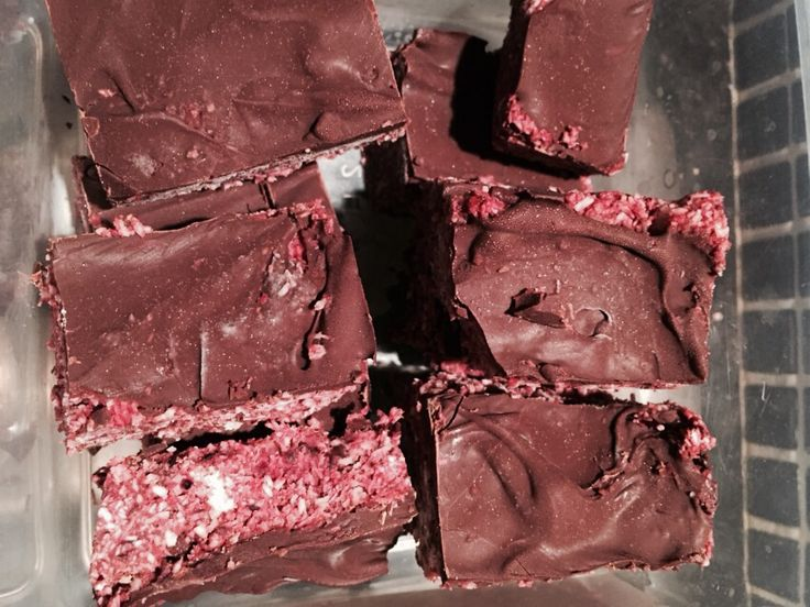 Raw Raspberry Cherry Slice Made with chopped frozen cherries, raspberries, desiccated coconut, puréed prunes, melted chocolate.
