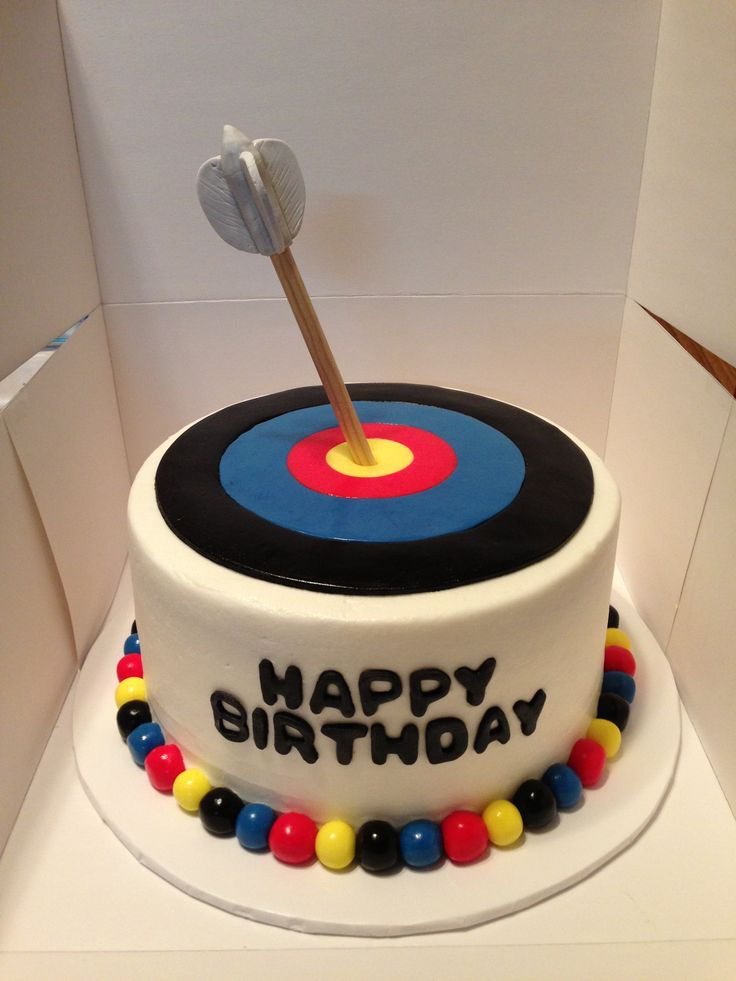 Archery target cake. Fondant target tops an eight inch cake. Arrow made of wooden dowel with gumpaste feathers.