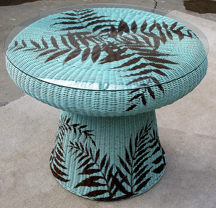 Wicker table I bought on the cheap at a thrift store....I repainted with a base coat then hand painted palm fronds in dark chocolate...for sale on Craig's List LA...project by Mark W. Patterson