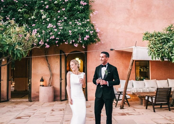 Couple during cocktail hour | Destination wedding photography Kasbah Bab Ourika Morocco