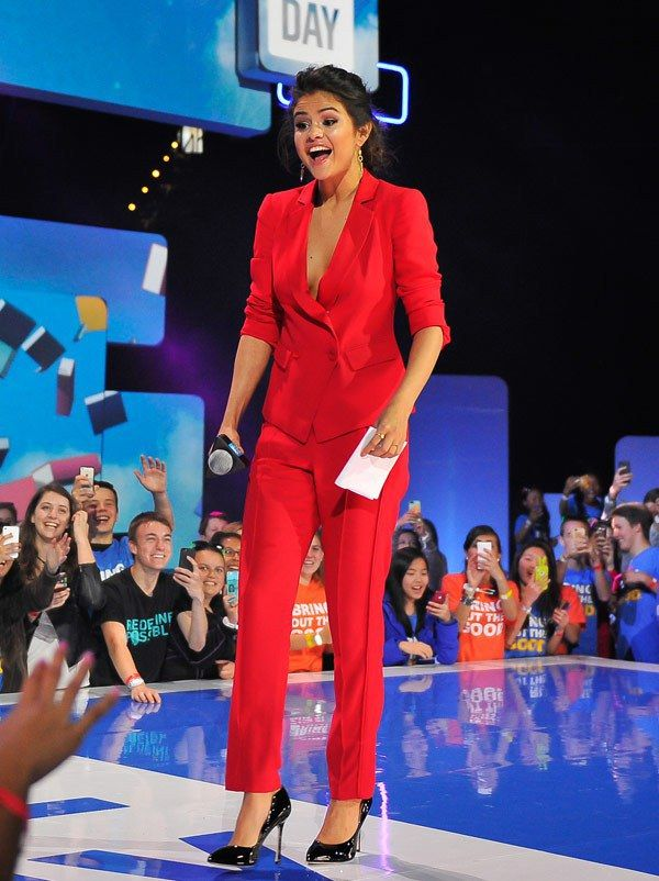 We are obsessing over Selena's red hot suit!
