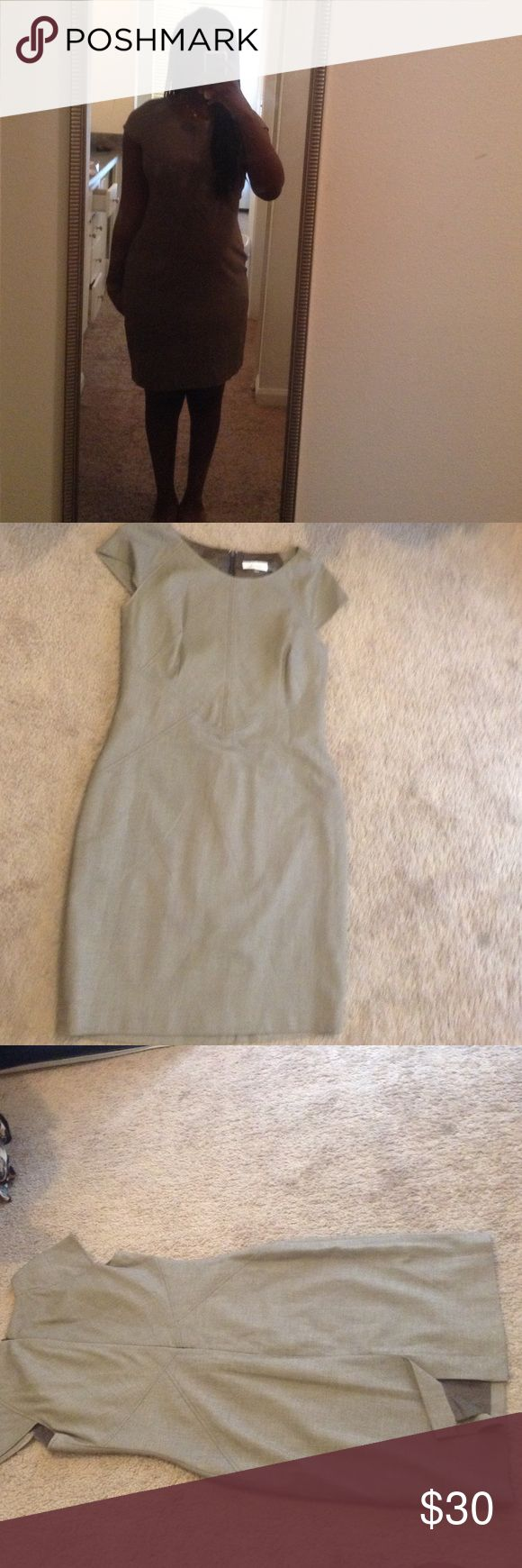 NWOT Calvin Klein Dress This dress has never been worn before, the tag is just missing. This dress is perfect for formal events, church, or even business meetings. It's a neutral color that is appropriate for any occasion really. Calvin Klein Dresses Midi