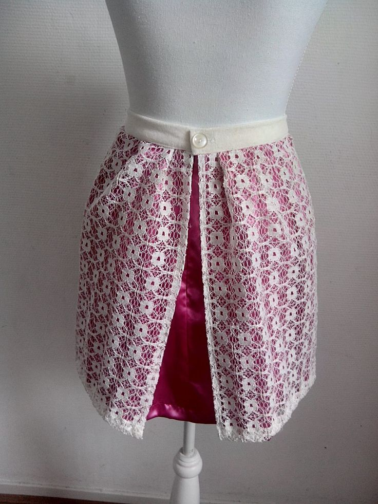 Waste textile designerskirt back. Stunning skirt from discarded pink satin and discarded lace curtain fabric.
