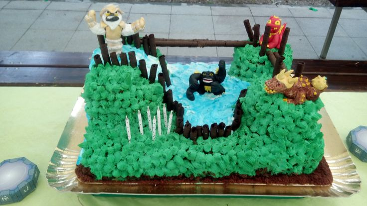 Skylanders cake. The figures are made on fondant and the rest in colored whipped cream