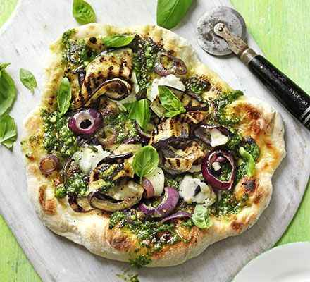 Pesto pizza with aubergine & goat's cheese. A vegetarian pizza with green basil sauce and creamy cheese that can be made in the oven or on a barbecue