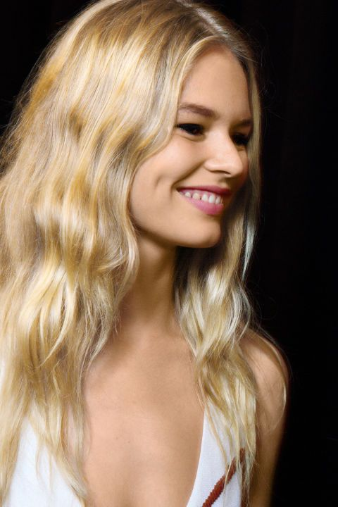 It's not too early to road-test spring's hottest trend: tousled tresses. Spotted on the runways of Emilio Pucci, Valentino, and Narciso Rodriguez (to name a few), these coils look most modern when paired with a center part and just the right amount of bend, says celebrity hairstylist Adir Abergel. Pictured: Narciso Rodriguez