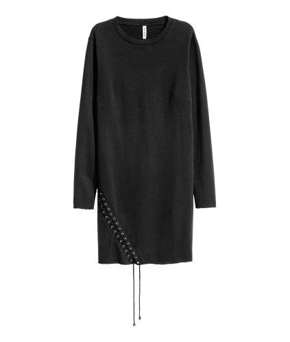 Black. Straight-cut dress in sweatshirt fabric with long sleeves, decorative lacing at one side and raw-edge cuffs and hem.