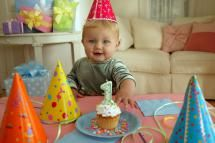 Boy's first birthday. - Elyse Lewin/Stockbyte/Getty Images