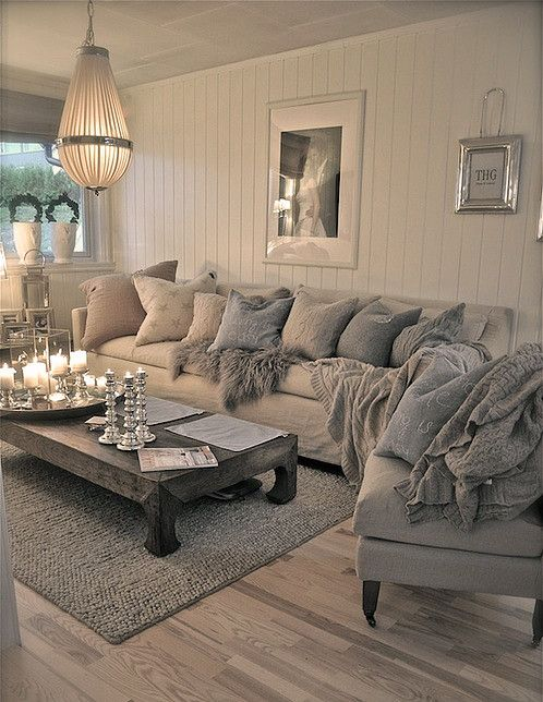 This attractive array of scatter cushions and throws are in a stunning palette of greys and neutrals - perfect for blending with the antique white wooden flooring and walls. #interiordesign #neutralcolours