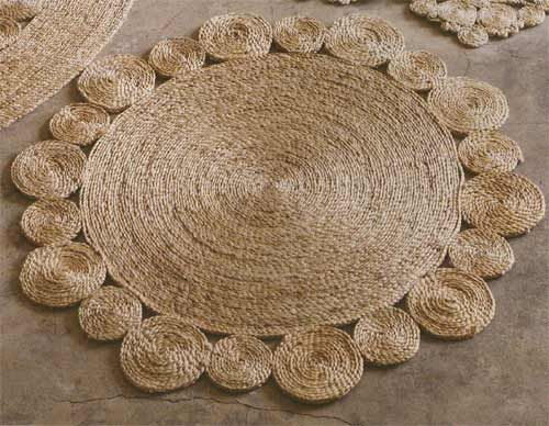 You can sew together sections of coiled up twine or natural rope to make a sturdy and organic looking area rug. Nicety shows you how in this tutorial.