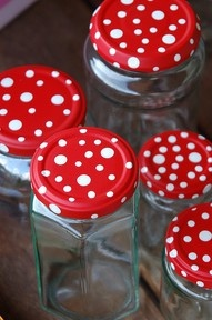 """twist off glass lids from jam, tomato sauce, cucumbers... to style up kitchen or crafting place. Spray jar caps with simple paint in a tin can. The best result for the dots you get, if you use nail or screw heads. Dab it in a speckle of the white varnish and then onto the cap, don´t press, just dab. Use different nail/screw sizes."""" data-componentType=""""MODAL_PIN"""