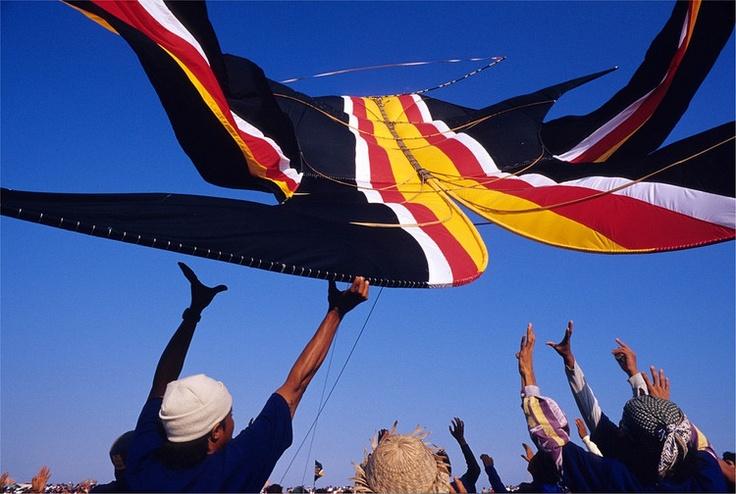 """A team launches a massive humming """"Bebean"""" kite at the Baki Kite Festival at Sanur Beach, Bali, Indonesia."""