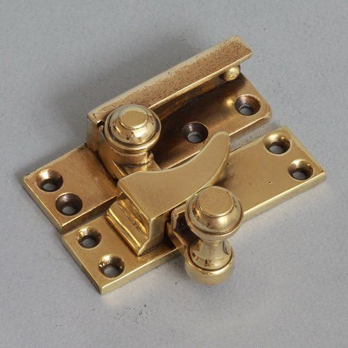 A top quality solid cast bronze or pink brass sash window lock by Gibbons of Wolverhampton. In great condition with good spring and snappy action. Suitable for narrower windows as the mounting plates are only 2 cm wide.