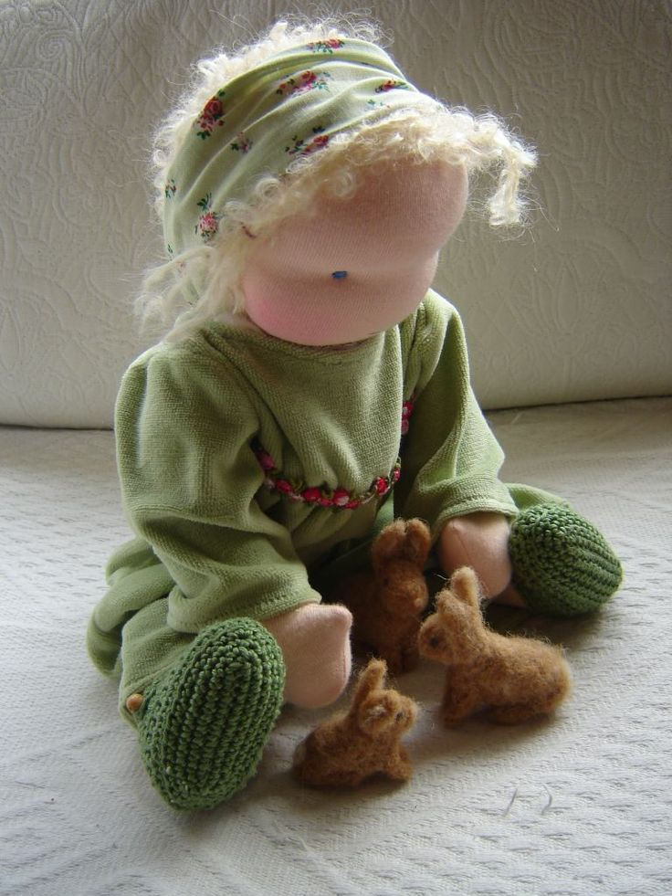 waldorf doll playing with bunnies