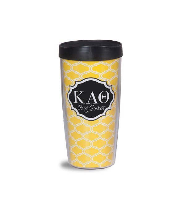 Yellow/black Kappa Alpha Theta Big Sis Trellis Acrylic Tumbler with black lid. 16 oz. tumbler is designed for both hot and cold beverages. Dishwasher and microwave safe. Made in the USA and has a lifetime guarantee. Great gift for your Big Sister!! Sassy Sorority is a licensed Greek vendor for 23 National Panhellenic sororities