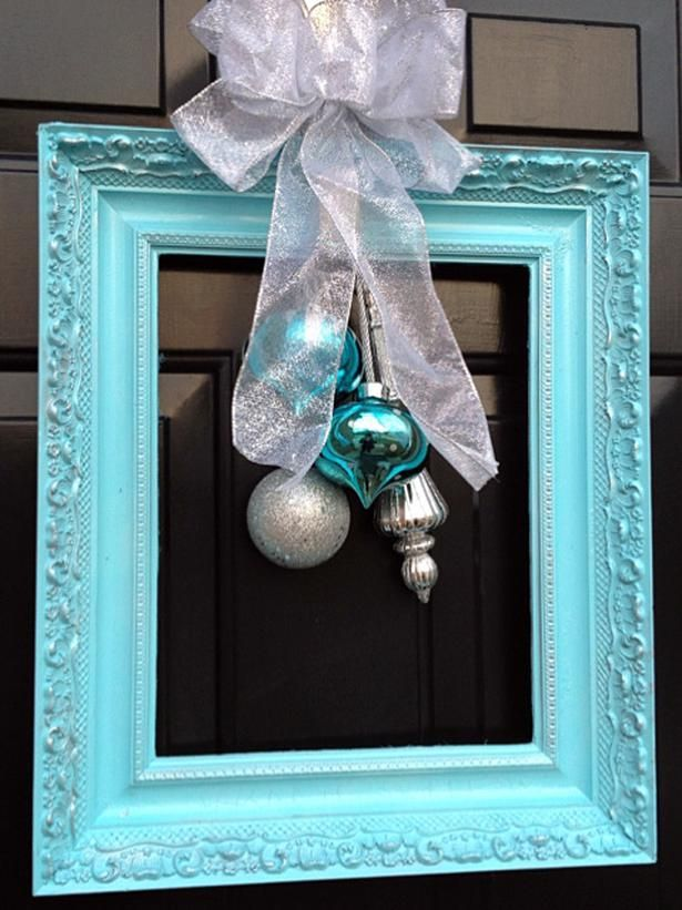 Think outside the classic wreath circle. Try an upcycled frame for front door décor.