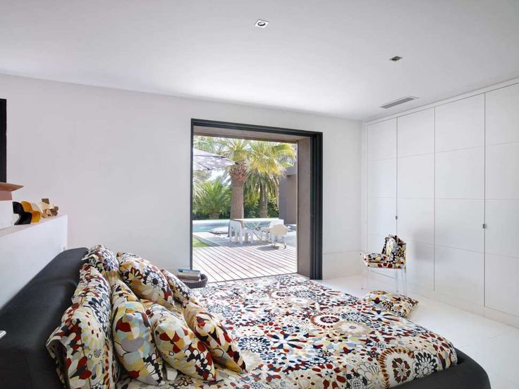 Hotels & Resorts:Amusing Bedroom Design Decorating With Colorful Duvet Plus Pillows With White Wardrobe And White Walls And Then Connected Backyard Along With Swimming Pool And Its Cozy Bedroom Design Ideas With Pool View Outstanding Cozy Villa With Nicely Colorful and Lovely Landscaped in France