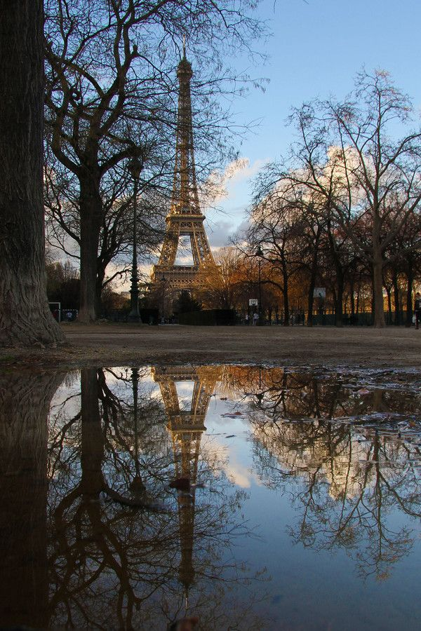 Eiffel tower reflection from the end of the Champs de Mars