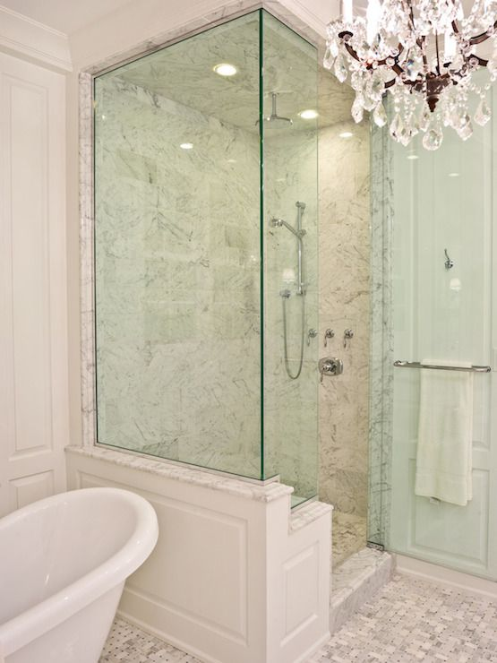 PLD Custom Homes - bathrooms - walk in shower, glass shower, glass walk in shower, seamless glass shower, rain shower head, marble shower surround, paneled shower, claw foot bathtub, bathtub chandelier, master bathroom chandeliers,