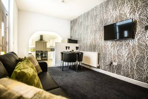 Storey House Barrow in Furness Storey House is located in Barrow in Furness, 3.4 km from Furness Abbey and 7 km from Lake Cruises.  All rooms include a TV. You will find a kettle in the room. Storey House features free WiFi throughout the property.