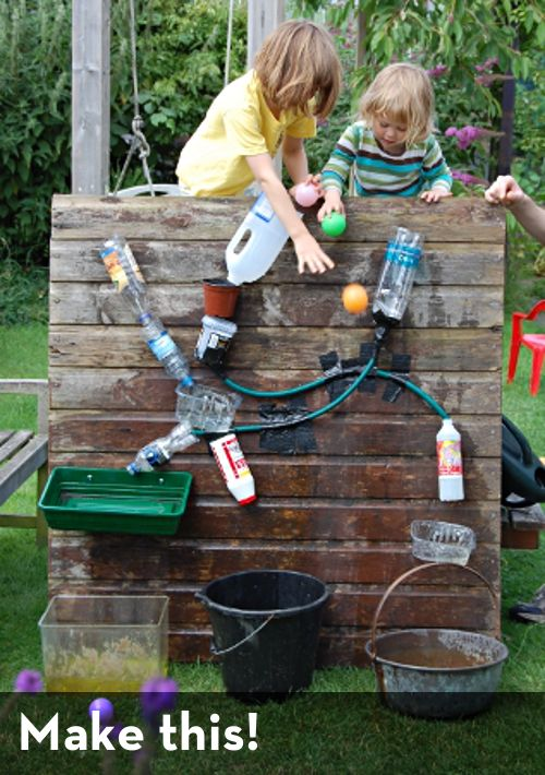 water play with multiple activities. It would be neat to have an area where several short hoses and sprayers with containers could be attached. I'd make it longer so that children would be spaced farther apart but I like the natural look of what appears to be a wooden wall and possible wooden steps or a bench behind it to provide better access from the top.