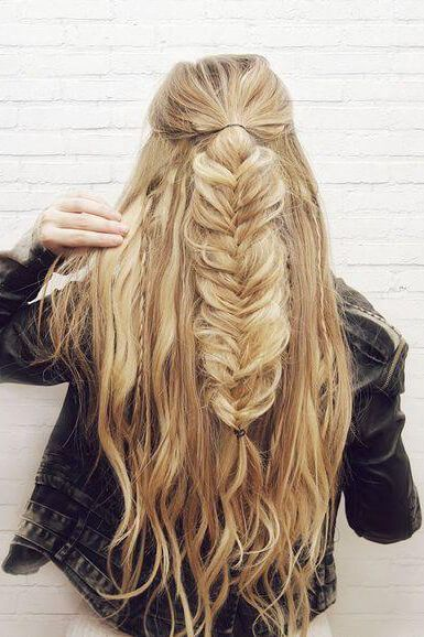 Girl with a half-up fishtail hairstyle. She looks beachy yet, chic with this coo...