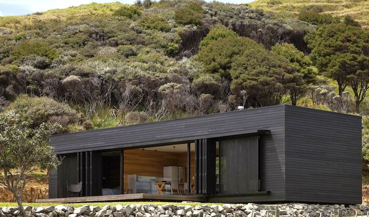 Off-Grid Storm Cottage is a Solar-Powered Timber Box on New Zealand's Great Barrier Island