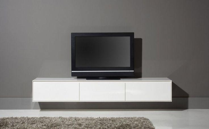 TV meubel Vision is duidelijk een van onze exclusieve modellen uit onze Cantomobili collectie. Een fraaie strakke belijning, vervaardigd in hoogglans wit; dit meubel ademt Italië! Het tv meubel heeft een riante breedte van 226cm, en met 3 kleppen kunt u al uw tv-apparatuur opbergen. Hydraulische pompjes in de kleppen, zorgen ervoor dat de klep langzaam open gaat. Een meubel van dit kaliber heeft natuurlijk 10 jaar garantie!
