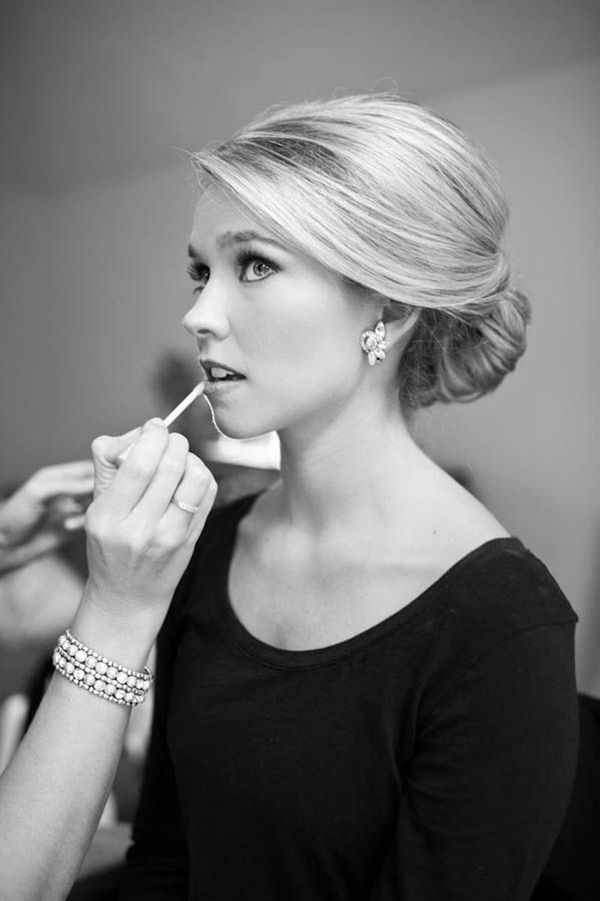 Must do wedding photo, bride getting makeup done.