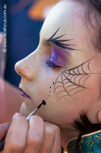 Witch face painting by facefocus, via Flickr