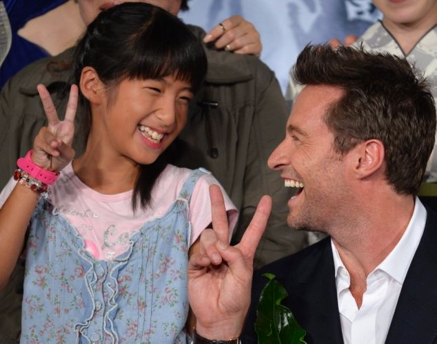 Australian actor/cast member Hugh Jackman (R) flashes the victory sign with a young Japanese girl during the Japanese premiere of the movie ...